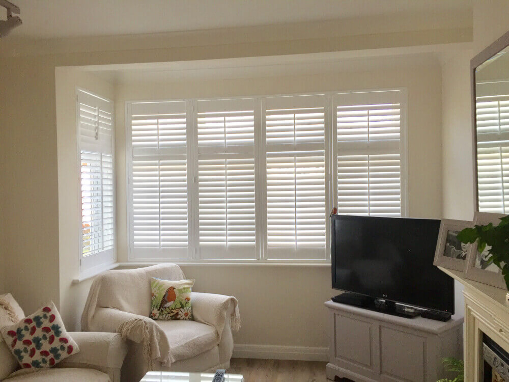 Living Room Bay Window Full-Height Hybrid Shutters